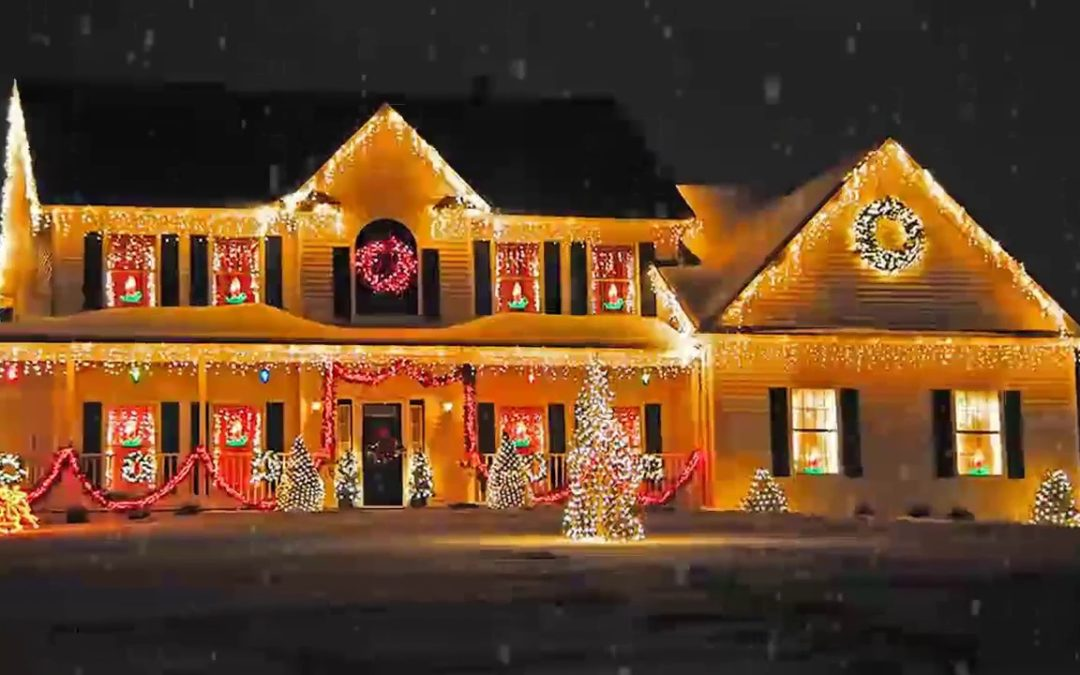 Large home covered with holiday lights